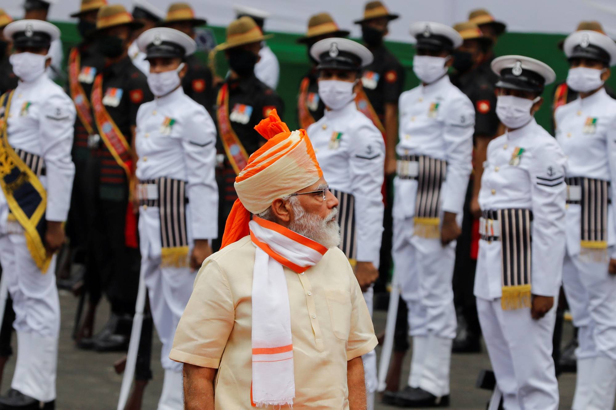 Indian Prime Minister Narendra Modi inspects an honor guard during Independence Day celebrations at the historic Red Fort in New Delhi in August 2020. | REUTERS