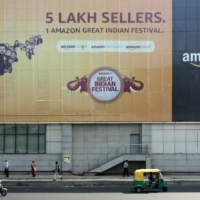 An Amazon India billboard outside a metro station in New Delhi | REUTERS