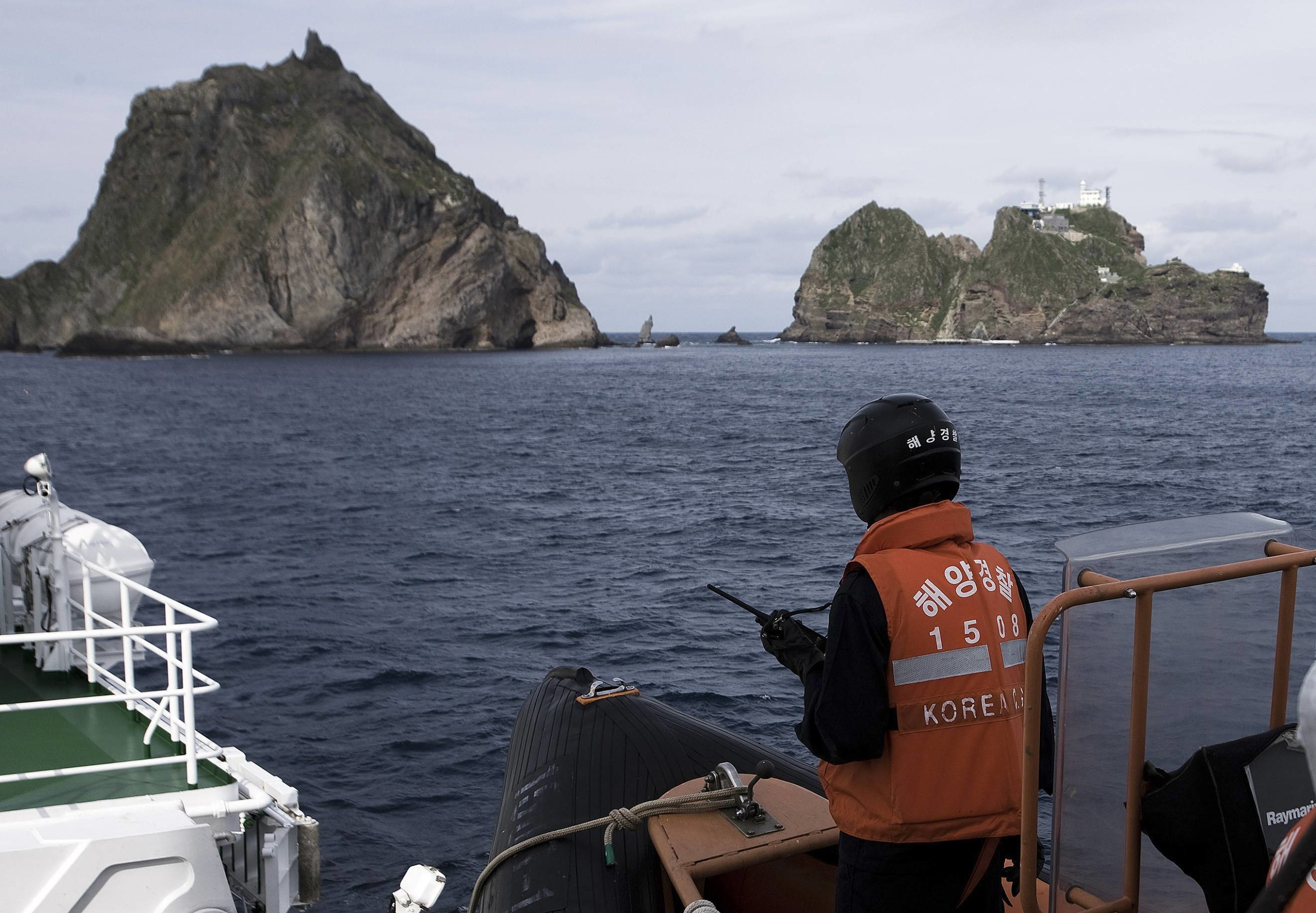 The South Korean Coast Guard patrols waters near disputed islets called Takeshima in Japanese and Dokdo in Korean. Shimane Prefecture exacerbated the dispute in 2005 when lawmakers there declared Feb. 22 to be Takeshima Day — even though more Japanese are likely to know the day as Cat Day.   | REUTERS