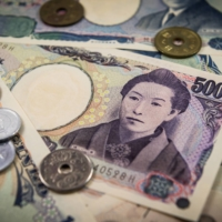Cash-loving Japan shifts from notes and coins in boost for banks