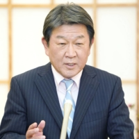 Foreign Minister Toshimitsu Motegi speaks to reporters Thursday at the ministry following an online meeting of foreign ministers from Quad group countries. | KYODO