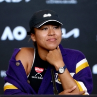 Naomi Osaka speaks at a news conference after winning her women's semi-final match against Serena Williams on Thursday. | AFP-JIJI