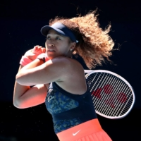 Naomi Osaka plays against Serena Williams in their semifinal match at Melbourne Park on Thursday. | REUTERS
