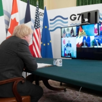 British Prime Minister Boris Johnson hosts a virtual meeting of Group of Seven leaders in the Cabinet Room at No. 10 Downing St. in London on Friday. | POOL / VIA AFP-JIJI