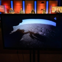 The first high-resolution, color image to be sent back by the Hazard Cameras on the underside of NASA's Perseverance Mars rover after its landing on Thursday is shown off during an initial surface checkout briefing at its Jet Propulsion Laboratory in Pasadena, California, on Friday.  | NASA / BILL INGALLS / VIA REUTERS