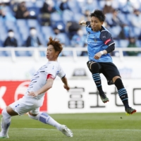 Frontale's Yu Kobayashi (right) scores the winner in the waning seconds of the match on Saturday. | KYODO