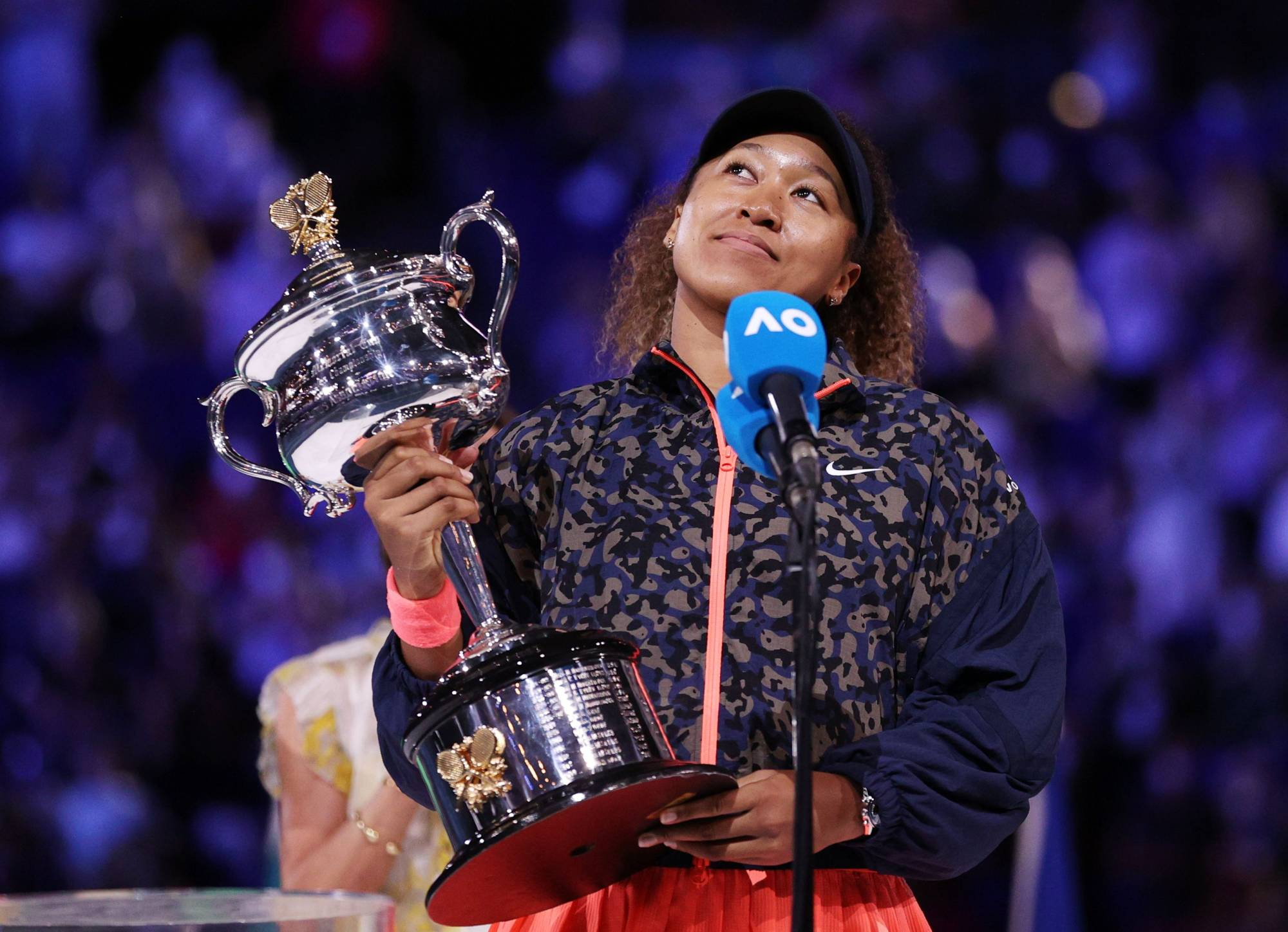 Naomi Osaka holds the trophy during an on-court interview after winning the Australian Open on Saturday in Melbourne.   REUTERS