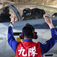 A pilot prepares to take off on a F-CK-1 Ching-kuo Indigenous Defense Fighter at an air force base in Tainan, Taiwan, in January.  | REUTERS