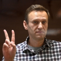 Russian opposition leader Alexei Navalny in a glass cell during a hearing at the Babushkinsky district court in Moscow on Saturday | AFP-JJJI