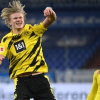 Dortmund forward Erling Haaland celebrates after his team's win over rival Schalke on Saturday in Gelsenkirchen, Germany. | AFP-JIJI