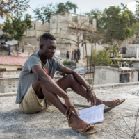 Kervens Casseus, 20, studies on the roof of his uncle's house on Feb. 18 in Port-au-Prince, Haiti.  | AFP-JIJI