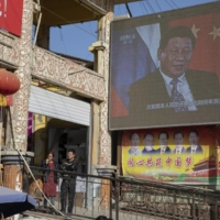 Chinese President Xi Jinping on a monitor in China's Xinjiang Uighur Autonomous Region