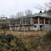 An elementary school building in Namie, Fukushima Prefecture, is seen deserted in January. Municipalities near the crippled nuclear power plant in Fukushima have been struggling to bring residents back. | KYODO