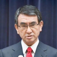 Taro Kono said he believes a system of vaccination certificates will not spread internationally. | POOL / VIA KYODO