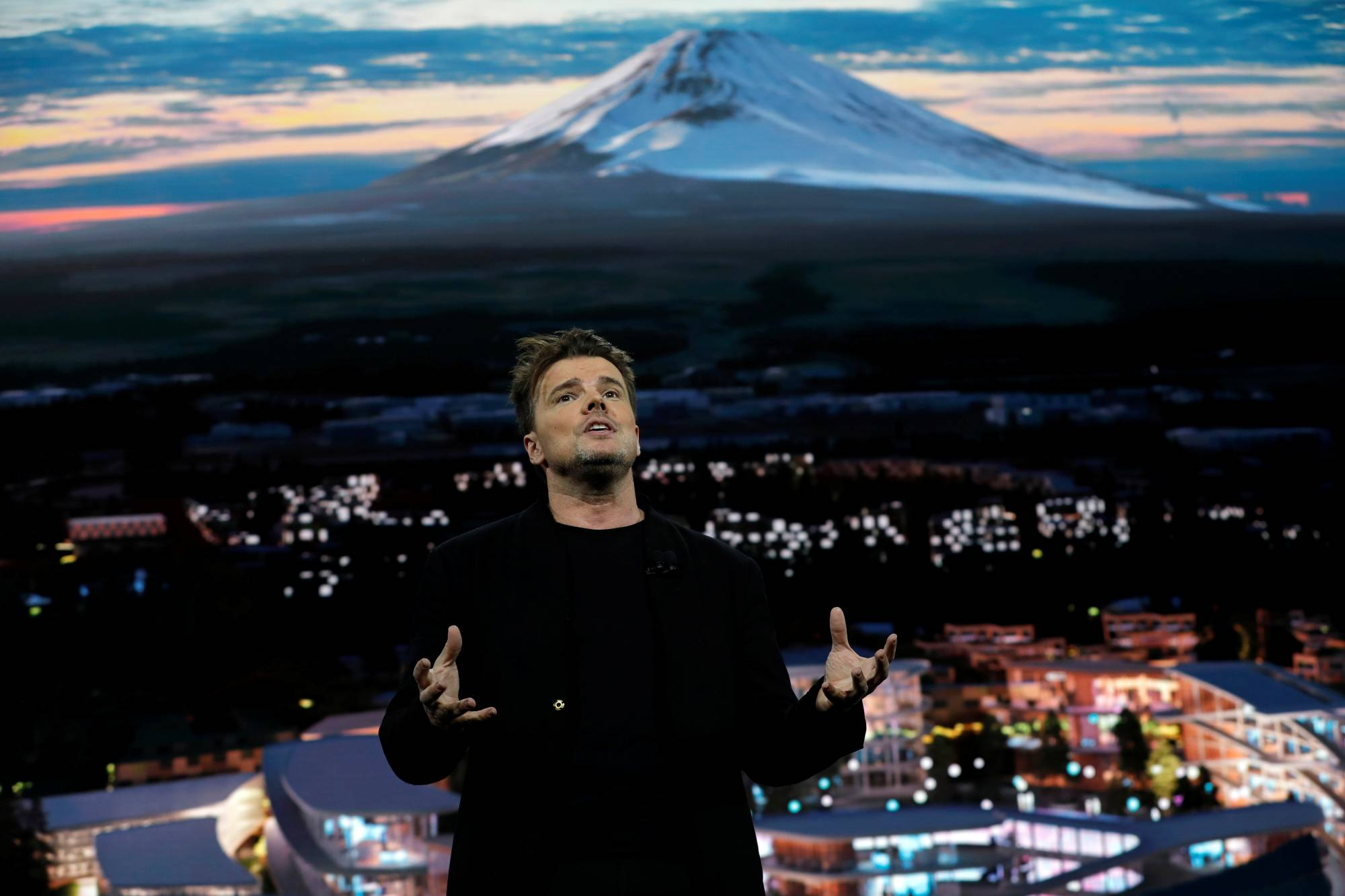 Danish architect Bjarke Ingels, CEO of Bjarke Ingels Group, talks about Woven City, a prototype city of the future on a 175-acre site at the base of Mt. Fuji in Japan, at a Toyota Motor Corporation news conference during the 2020 CES in Las Vegas in January 2020. | REUTERS