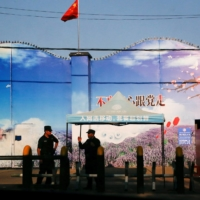 Security guards stand at the gates of what is officially known as a vocational skills education center in Huocheng County in Xinjiang Uighur Autonomous Region, China, in September 2018. | REUTERS