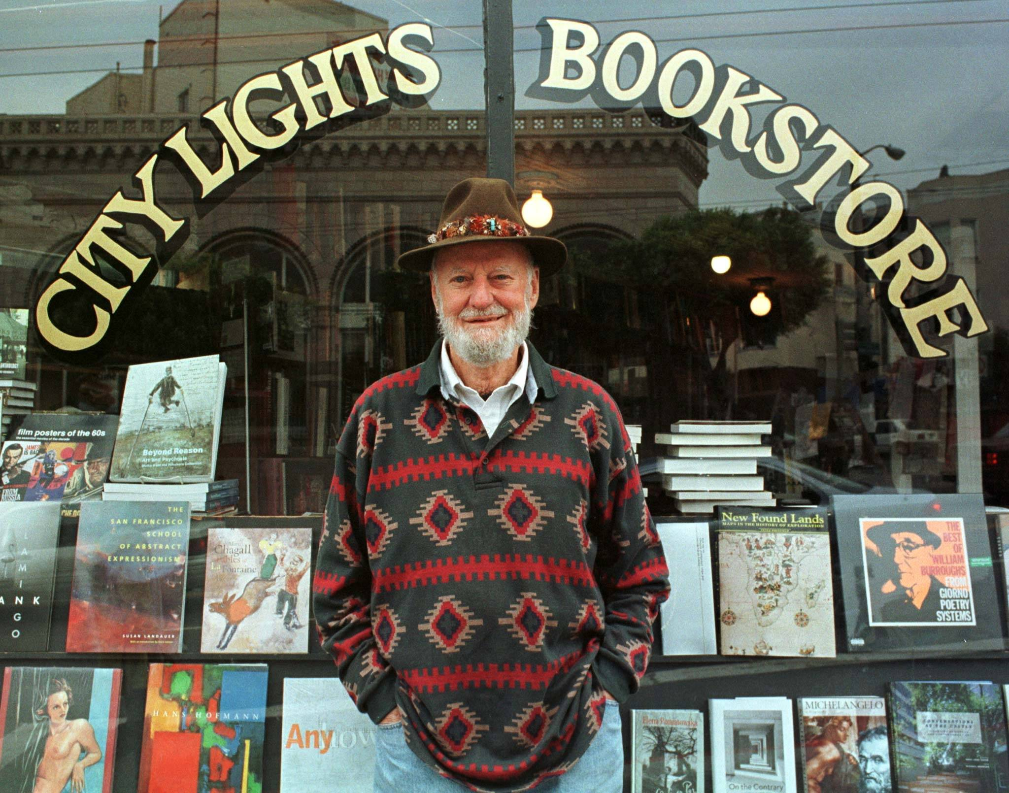 Lawrence Ferlinghetti stands outside his bookstore in San Francisco, California, in 1998. A poet, publisher and political iconoclast who inspired and nurtured generations of San Francisco artists and writers, Ferlinghetti died on Feb. 23, 2021, at his home in San Francisco. He was 101. | REUTERS