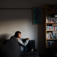 Nao, a blogger whose last name has been withheld to protect her privacy, at her home in Kanagawa Prefecture on Feb. 3. She has started writing a blog to chronicle her lifelong battles with depression and eating disorders, and has written candidly about her suicide attempt three years earlier. | NORIKO HAYASHI / THE NEW YORK TIMES