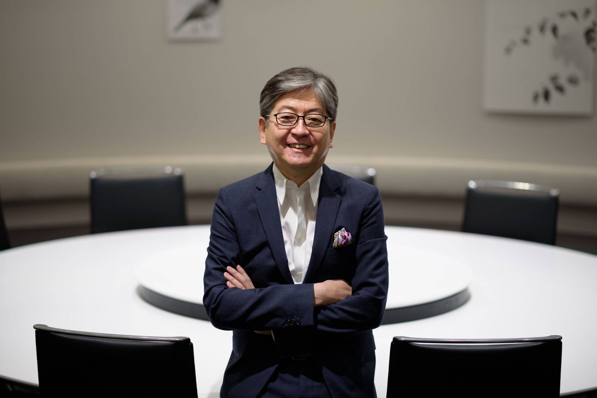 Oki Matsumoto, chief executive officer of Monex Group Inc., poses for a photograph in Tokyo in May 2018. Monex has been diversifying into cryptocurrency as intensifying competition dims prospects of its mainstay stock brokerage business. | BLOOMBERG