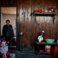 Although Liu Qingyou received a grant as a poverty-stricken household, he says business has been weak. | AFP-JIJI