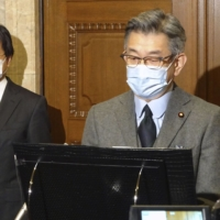 Internal Affairs and Communications Minister Ryota Takeda speaks at a news conference at the Diet on Wednesday. | KYODO
