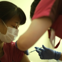 One shot or two? Japan weighs question as vaccine rollout stalls amid shortages