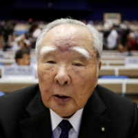 Osamu Suzuki stepped down as president in 2015 at age 85, when he handed the post to his son, Toshihiro Suzuki, but remained as chairman. | REUTERS