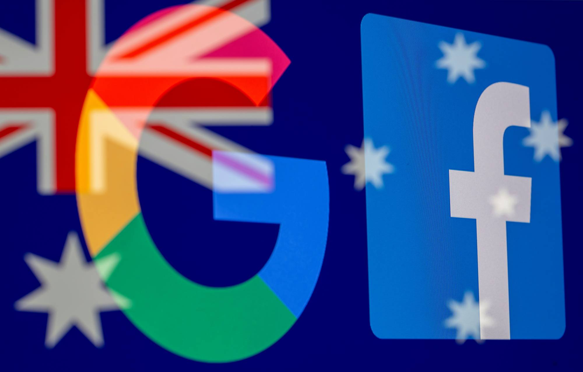 Australia passes law to make Facebook and Google pay for news