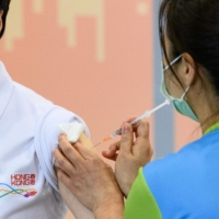 Cautious Asian nations start deploying vaccine now proven elsewhere