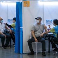 China's Sinovac COVID-19 vaccine is administered at a community vaccination center in Hong Kong on Tuesday.  | AFP-JIJI