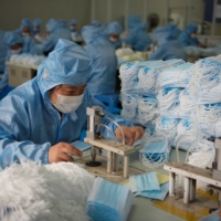 The COVID-19 pandemic made clear that there is too much reliance by the world on China for the production of many essential products, including personal protective equipment. | CHINA DAILY / VIA REUTERS