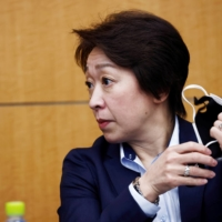 Tokyo 2020 Olympics Organising Committee President Seiko Hashimoto released guidelines Thursday for COVID-19 measures to be taken during the upcoming torch relay. | POOL / VIA REUTERS