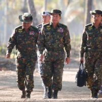 Myanmar military commander Gen. Min Aung Hlaing (center) and senior commanders arrive for joint exercises in the Irrawaddy Delta region in 2018. | POOL / VIA AFP-JIJI