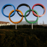 The Olympic rings are pictured in front of the International Olympic Committee headquarters in Lausanne, Switzerland, on Wednesday. | REUTERS