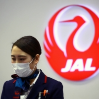 Japan Airlines halted recruitment activities in the middle of the year in the wake of the pandemic and decided to hire only 200 new graduates in the 2021 business year. | REUTERS