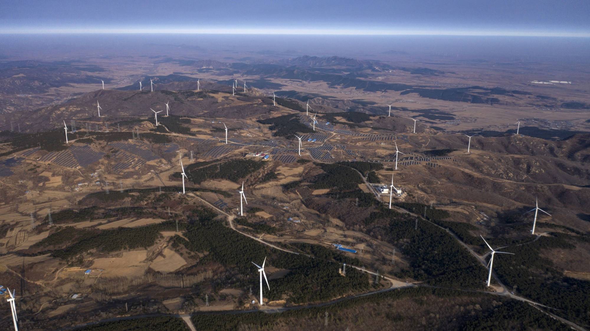 China's ruling Communist Party's politburo said in November that the five-year plan should promote low-carbon energy and support efforts to quickly bring emissions to a peak in some regions. | BLOOMBERG