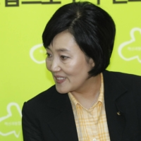 Moon Jae-in, now South Korean president, and Park Young-sun, a candidate to be the next mayor of Seoul, in 2011.  | REUTERS