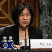 Katherine Tai, nominee to become U. S. trade representative, testifies before the Senate Finance Committee during her nomination hearing in Washington on Thursday. Tai promised committee members that she would aggressively enforce American trade rules against China, Mexico and other trading partners. | POOL / VIA THE NEW YORK TIMES