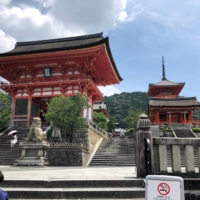 Few people can be seen at the entrance to the usually crowded Kiyomizu temple in Kyoto, a popular tourist attraction, in July 2020 amid the spread of the novel coronavirus. | REUTERS