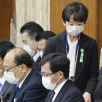 Cabinet Public Relations Secretary Makiko Yamada returns to her seat after answering questions during a House of Representatives committee meeting on Thursday. | KYODO