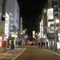 Few people are seen in the Nakasu entertainment district of Fukuoka on Friday night amid the coronavirus state of emergency. | KYODO
