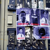 Posters in memory of late doctor Li Wenliang and other doctors are seen on a street near the Central Hospital in Wuhan, China, on the anniversary of Li's death on Feb. 7. | REUTERS