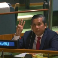Kyaw Moe Tun, Myanmar's ambassador to the U.N., makes a three-finger salute as he addresses an informal meeting of the General Assembly on Friday in New York.    YOUTUBE / UNITED NATIONS / VIA AFP-JIJI