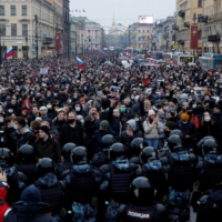 Law enforcement officers stand in front of participants during a rally in support of jailed Russian opposition leader Alexei Navalny in Saint Petersburg on Jan. 23.  | REUTERS