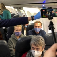 Russian opposition leader Alexei Navalny and his wife, Yulia Navalnaya, on a plane bound for Moscow on Jan. 17.  | REUTERS