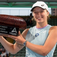 Iga Swiatek poses with the winner's trophy after defeating Belinda Bencic in the women's singles final at the Adelaide International on Saturday in Adelaide, Australia. | AFP-JIJI