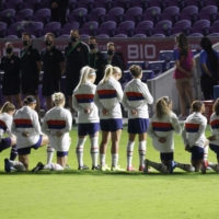 Members of the United States women's team team kneel during the national anthem before a SheBelieves Cup match against Canada on Feb. 18 in Orlando, Florida. | USA TODAY / VIA REUTERS