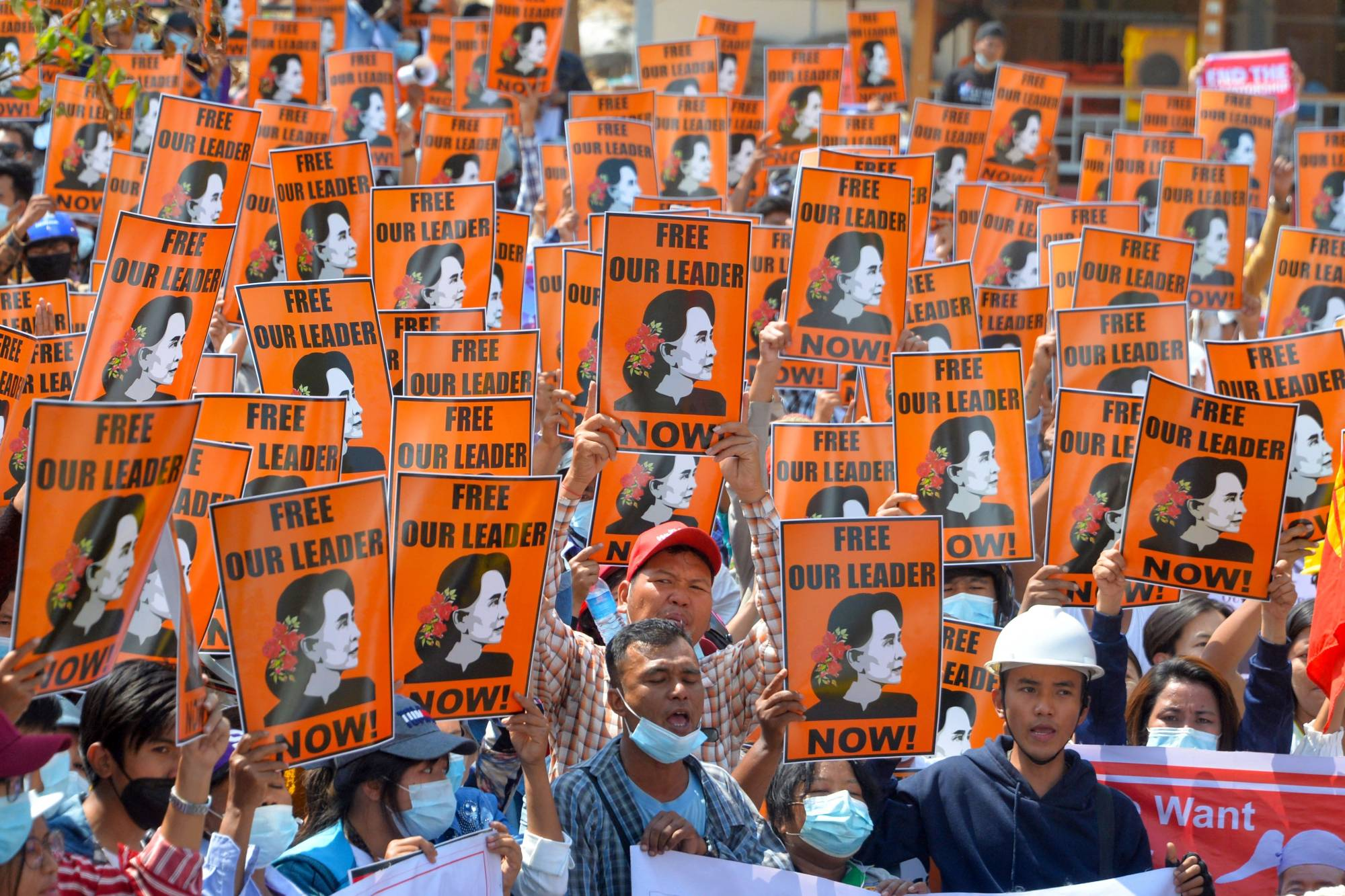 Protesters hold posters with the image of detained civilian leader Aung San Suu Kyi during a demonstration against the military coup in Naypyidaw on Sunday.    AFP-JIJI