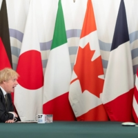 Britain's Prime Minister Boris Johnson hosts an online G7 summit in the Cabinet Room at Downing Street in London on Feb. 19. | POOL / VIA REUTERS
