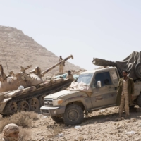 Yemeni government tank and truck-mounted guns operate near the front line in the battle against Houthi rebels in the mountainous region outside Sana'a, Yemen, in January 2018. The UAE began withdrawing from Yemen in late 2019 but maintained support for southern separatist fighters. | BLOOMBERG